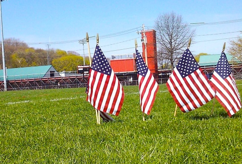 Our Patriotism is always on track. These flags graced the edges of the Watertown High School track, where my publicist did some CrossFit and sprints.
