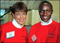 1996 Men's and Women's champions Uta Pippig (l) and Moses Tanui. (Globe Staff Photo / Frank O'Brien)